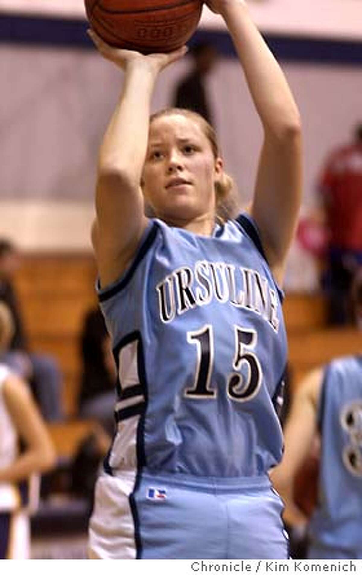 Ursuline High School basketball player Christy Titchenal has just signed with Stanford for next year. She is shown with her team in a game against Ukiah in the Marin Catholic Tournament in Kentfield. KIM KOMENICH/The Chronicle