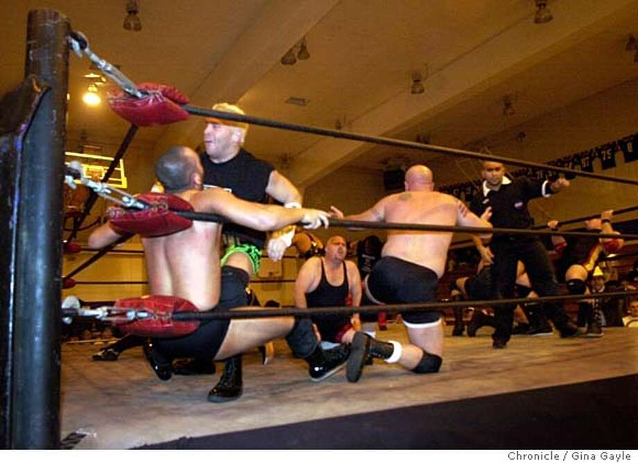 EBWRESTLE029.JPG The first match of the eveing was a 15 man Battle Royal when Pro-Wrestling Iron hosted a series of matches at Pinole Valley High School. 9/27/03 in Pinole. GINA GAYLE / The Chronicle Photo: GINA GAYLE
