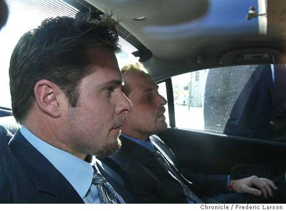 ; N.Y Yankee's slugger Jason Giambi (next to unknown person) showed up at the S.F Federal Building to testify before a grand jury investigating a lab that supplies some top athletes with nutritional supplements. Chronicle photo by Frederic Larson The Chronicle; Photo: FREDERIC LARSON
