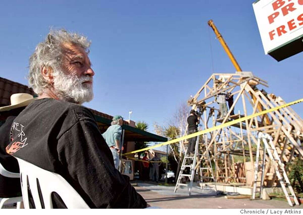 David Best turns away as the workers dismantle the Chapel he built for the day laborers in the Cannel District of San Rafael, Feb.3, 2005. Stop Work was demained by the San Rafael Building Department of David Best's Chapel built for the day laborers in the Canel District, Tuesday Feb. 1, 2005. Petaluma artist David Best, well-known for his Burning Man temples, was commissioned to build a project by the San Rafael Arts Council. He started to build a Chapel of the Laborers for the day laborers in the Canal district and was about two-thirds finished when it got red-tagged by the city yesterday for not being up to building code LACY ATKINS/SAN FRANCISCO CHRONICLE