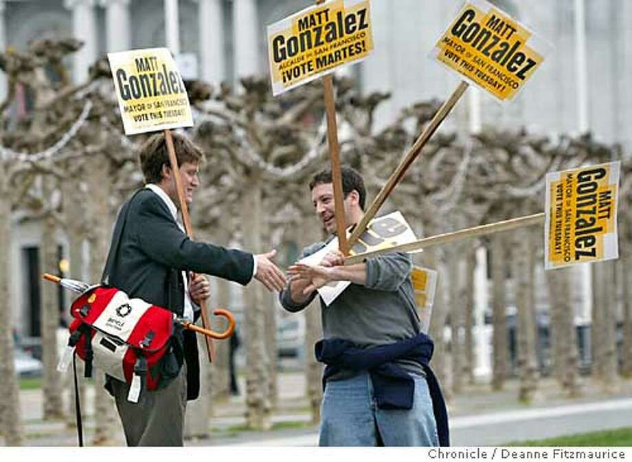 (l to r) Josh Hart with the SF Bicycle Coalition and Michael Sandler introduce themselves to each other. Voters turned out for the San Francisco run-off mayoral election.  Shot on 12/9/03 in . Deanne Fitzmaurice / The Chronicle Photo: Deanne Fitzmaurice