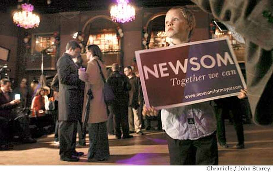 newsom_029_jrs.jpg  Gavin Newsom's victory party at the Fillmore. Justin Reid, 9, of San Francisco waits for the party to begin.  12/9/03 in San Francisco. JOHN STOREY / The Chronicle Justin Reid, 9, waits for the victory party for Gavin Newsom to begin at the Fillmore Auditorium. Newsom will be the 42nd mayor of San Francisco and one of the youngest in city history. ProductNameChronicle Photo: JOHN STOREY