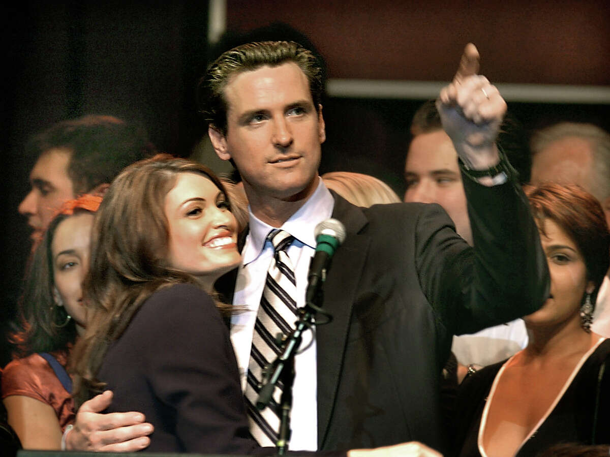 Gavin Newsom and then-wife Kimberly Guilfoyle at Newsom's mayoral victory party at the Fillmore on December 9, 2003 in San Francisco.