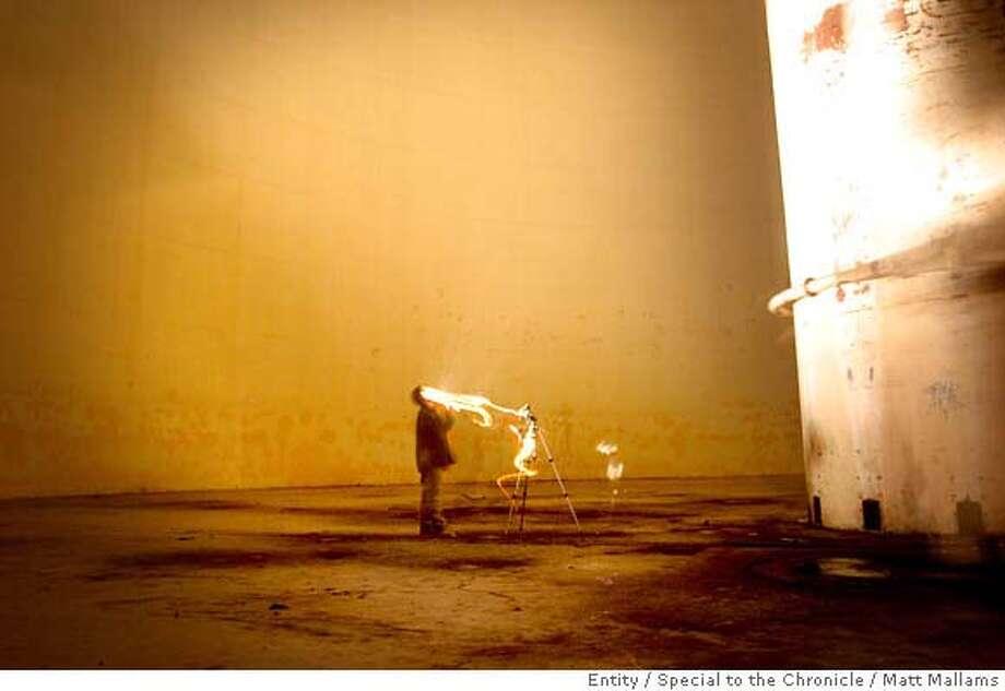 John Haeber photographs the inside of an abandoned sugar refinery by using a technique called light painting. Betteravia, CA. 6.1.07 (Photo by Matt Mallams/ Freelance for the San Francisco Chronicle) Photo: Matt Mallams