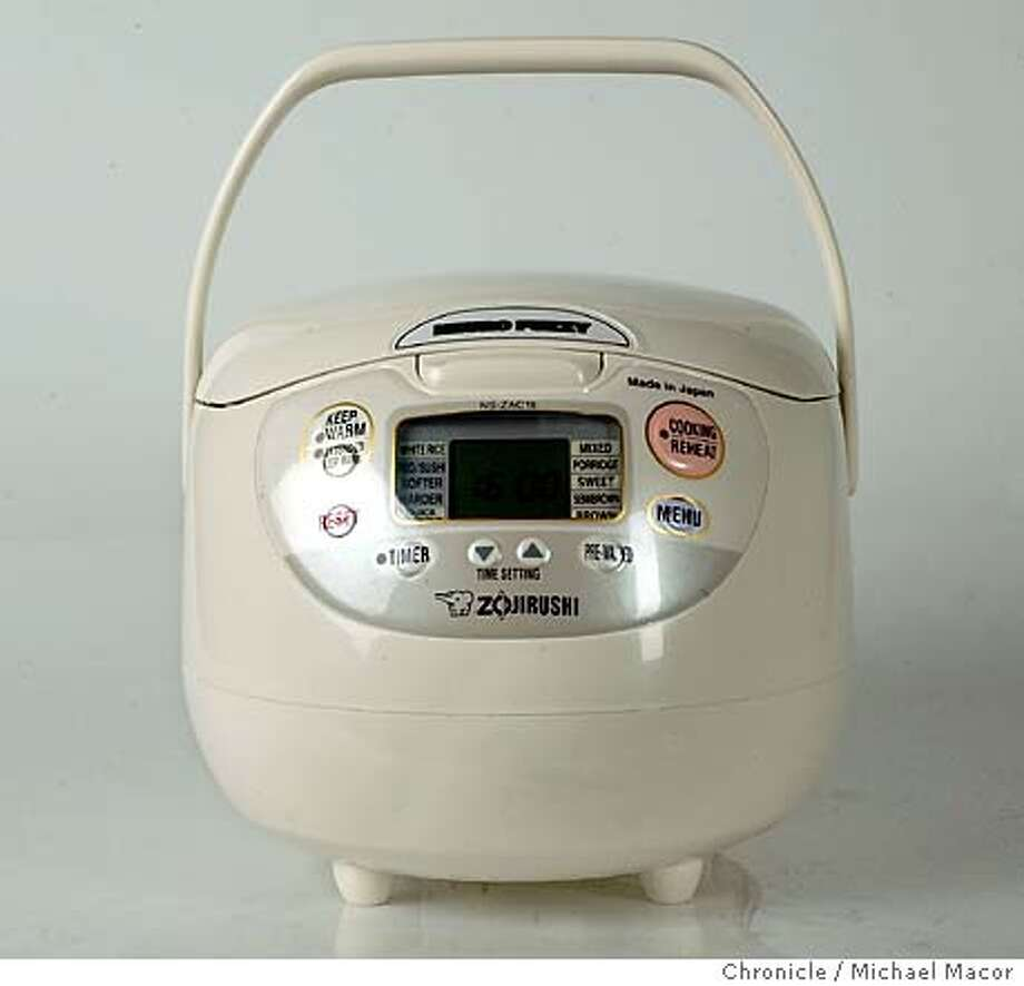 "ricecooker076_mac.jpg "" Zojirushi"" Rice Cooker. Testing rice cookers. Looking at three different models.  11/12/03 in STUDIO. MICHAEL MACOR/ The Chronicle Photo: MICHAEL MACOR"