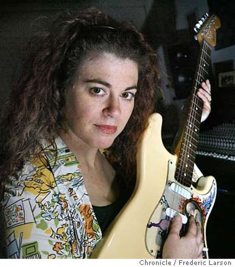 ; Karney (NOTE; please check on her name, photo assgnment had no last name) is a rock musician who makes video game soundtracks and works out her home recording in her studio.  The Chronicle; Photo: FREDERIC LARSON