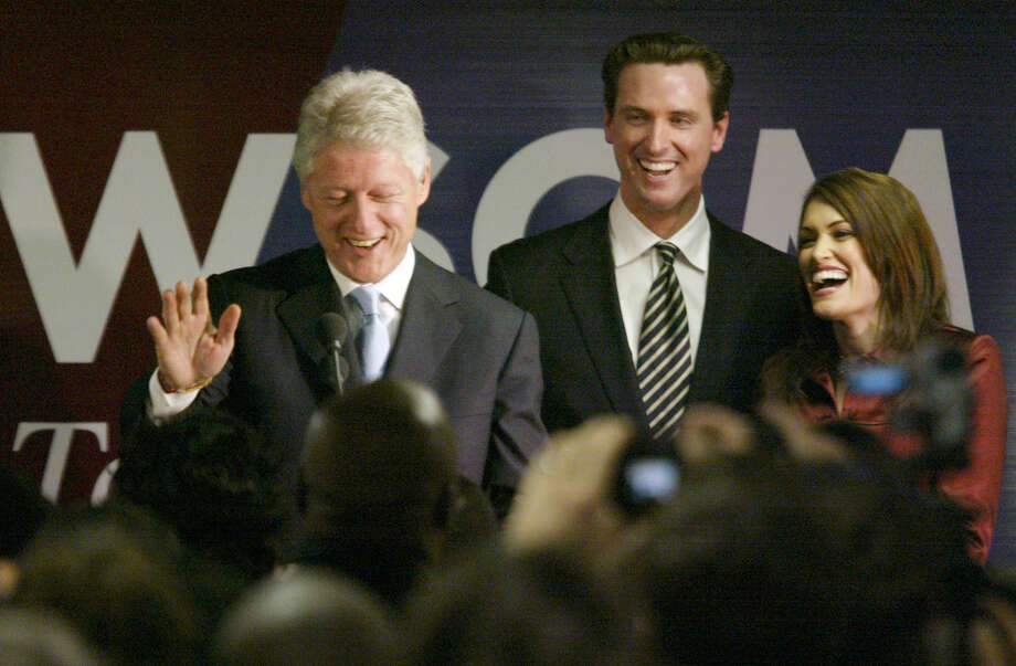 Former president Bill Clinton stopped by Gavin Newsom's campaign HQ to offer his support to Newsom and his campaign workers. Newsom's wife, Kimberly Guilfoyle-Newsom is at right.  MICHAEL MALONEY / The Chronicle Photo: MICHAEL MALONEY