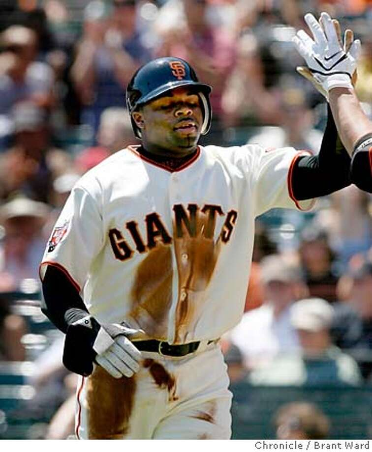 giants10_276.JPG  Rajai Davis gets congrats from Kevin Frandsen after scoring the first Giants run.  Giants vs. Washington Nationals in final game of a four game series at AT&T Park Thursday.  {By Brant Ward/San Francisco Chronicle}8/9/07 Photo: Brant Ward