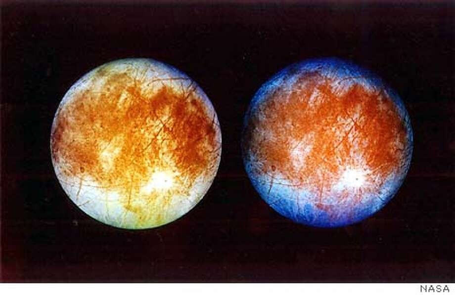 FOR IMMEDIATE RELEASE--These computer-enhanced images, released Nov. 12, 1996, by the Jet Propulsion Laboratory in Pasadena, Calif., show two views of Jupiter's ice-covered moon, Europa. Scientists believe the moon has an ocean of water beneath it's icy exterior, raising the possibility that there is life there. This image was taken Sept. 7, 1996, by the Galileo spacecraft. (AP Photo/NASA) Photo: HO