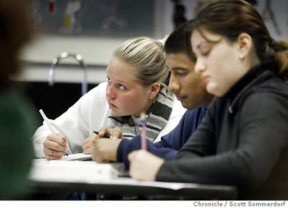 Student Justine Steele takes notes during Dee Medberry's Oceanology class. To the right are Diego Marcos (center) and Marlene Garcia (right) at Independance High School in San Jose, Wednesday November 5th, 2003. All pictured are seniors. 11/5/03 in San Jose, CA.  SCOTT SOMMERDORF / The Chronicle Photo: SCOTT SOMMERDORF