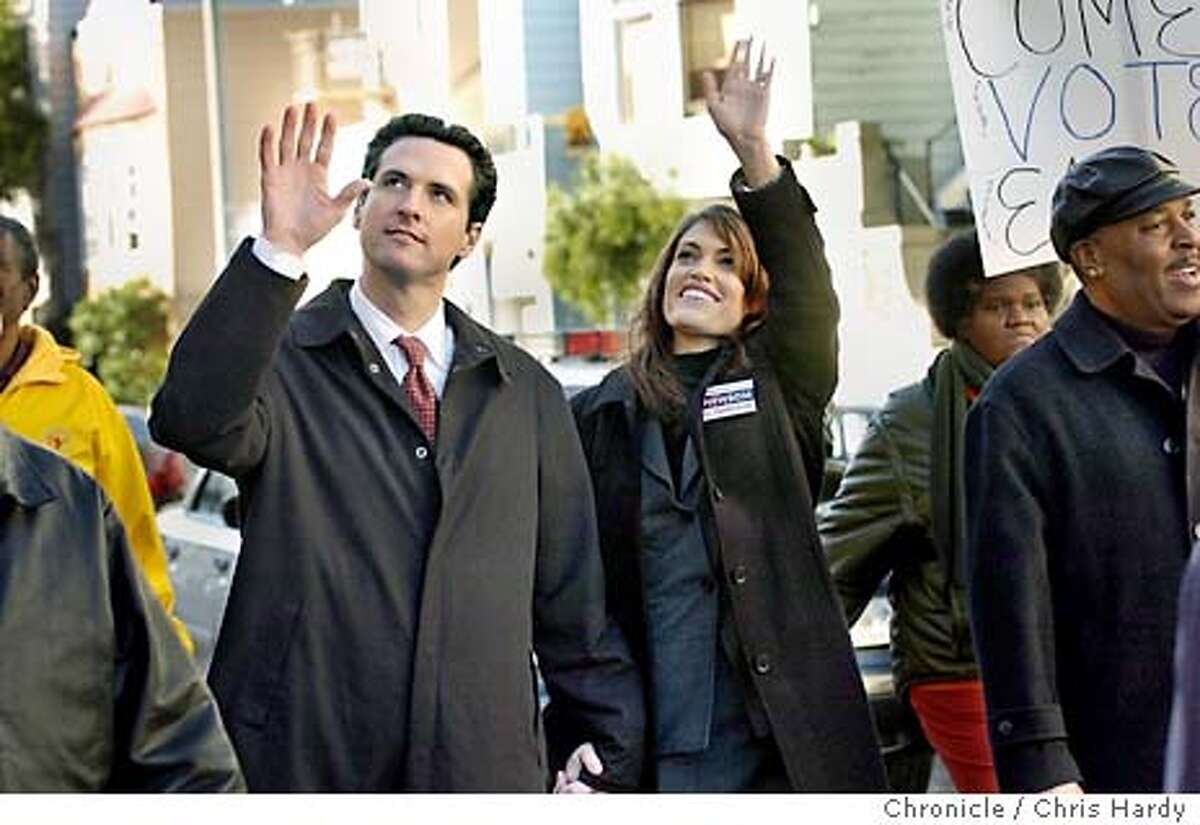 mayor08017_ch.JPG Gavin Newsom and wife Kimberly in voters pride march on sunday before the election Event on 12/7/03 in San Francisco. CHRIS HARDY / The Chronicle