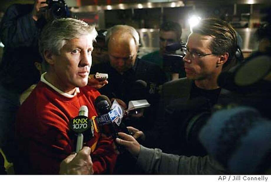 Southern California football coach Pete Carroll talks to the media after they heard the BSC rankings announced at the Galen Center on the USC campus in Los Angeles on Sunday, Dec. 7, 2003. Southern Cal was ranked third, which means they will play in the Rose Bowl instead of the Sugar Bowl. (AP Photo/Jill Connelly) Coach Pete Carroll discusses his team's fate after top-ranked USC didn't qualify for the national title game. Photo: JILL CONNELLY