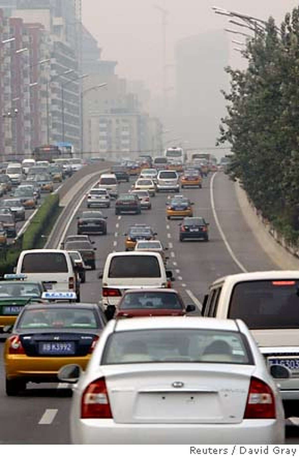 A car with no licence plates drives along a main road in Bejing August 17, 2007. Beijing embarked on a four-day experiment on Friday to see if taking 1.3 million cars off the city's streets will substantially reduce air pollution at next year's Beijing Olympics. The plan involves drivers with an even final digit on their licence plate facing fines if they take to the city roads today and Sunday, while odd numbered cars are banned Saturday and Monday. REUTERS/David Gray (CHINA) 0