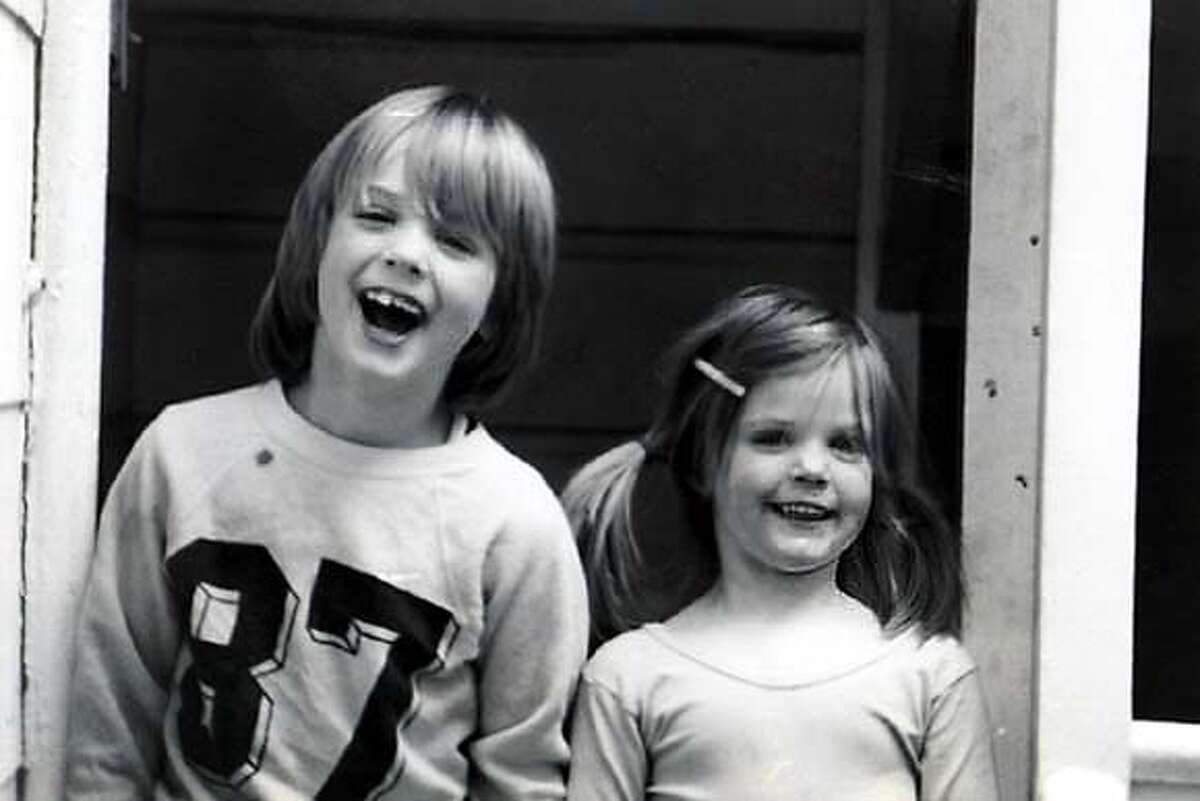 A young Newsom clad in a sporty sweatshirt mugs for the camera with his sister, Hilary. Sports became a big part of growing up for Newsom, whose accomplishments landed him on the cover of the Marin Independent Journal. Photo courtesy of Newsom family
