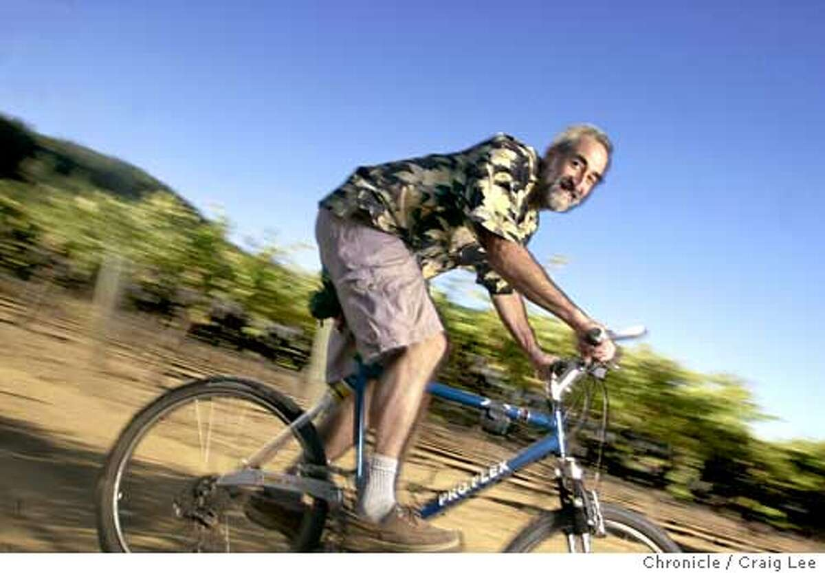 Winemakers to watch. Photo of Tom Rinaldi, winemaker at Provenance Vineyards in St. Helena. Photo of Tom Rinaldi an avid bike rider, he uses his bike to ride through the vineyards. Event on 10/20/03 in St. Helena. CRAIG LEE / The Chronicle