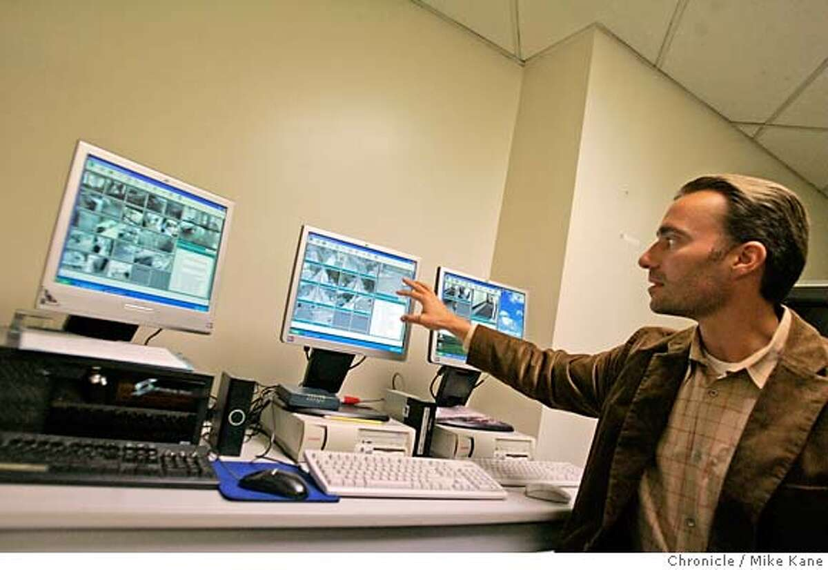 CAMERA17_157_MBK.JPG San Francisco Housing Authority Assistant general Counsel Tim Larsen looks over video feeds from property surveillance cameras at SFHA offices in San Francisco, CA, on Thursday, August, 16, 2007. photo taken: 8/16/07 Mike Kane / The Chronicle *Tim Larsen Gregg Fortner MANDATORY CREDIT FOR PHOTOG AND SF CHRONICLE/NO SALES-MAGS OUT