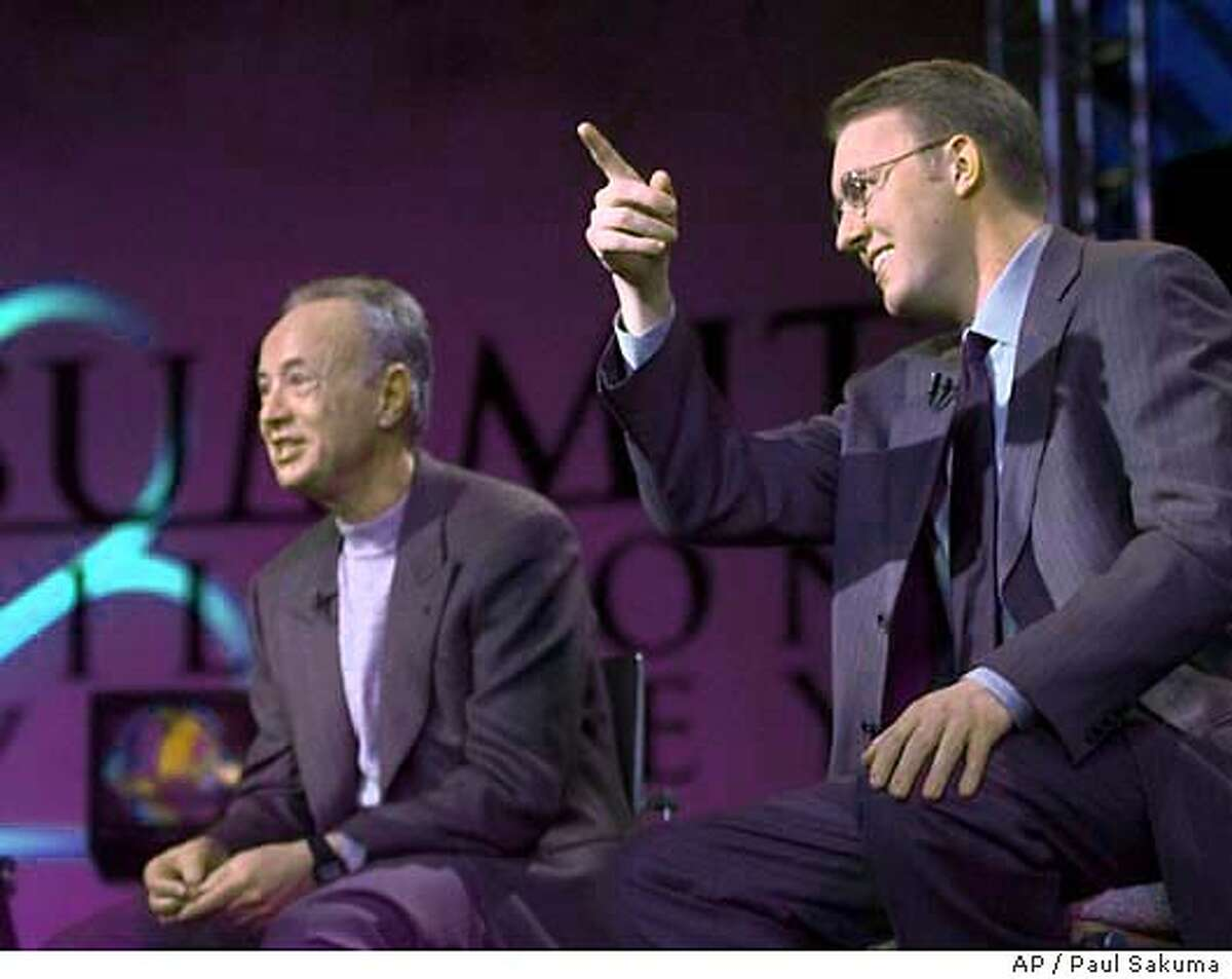 """Marc Andreessen, right, chairman of Loudcloud and founder of Netscape, gestures in front of Intel Corp. founder and chairman Andy Grove, left, as they participate in a live broadcast of """"Summit in Silicon Valley"""" that was put on by MSNBC in Stanford, Calif., Sunday, Feb. 27, 2000. (AP Photo/Paul Sakuma) CAT"""