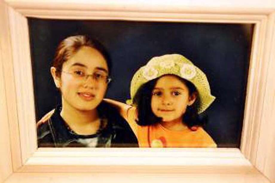 Yasmine and Sara Pourhashemi. sisters who fled their father in Iran and are in the Belgian Embassy in Tehran.  photo from Le Soir, Belgium.