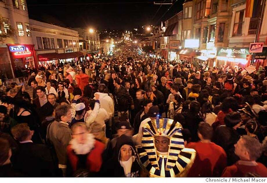"""halloween_castro_158_mac.jpg Castro St. packed with party goers. Geo Ivery dressed as a """"Pharoah"""". Halloween in the Castro of San Francisco. Event in, San Francisco, Ca, on 10/31/06. Photo by: Michael Macor/ San Francisco Chronicle  Ran on: 11-01-2006  This rainbow gathering in front of the Castro Theater was a bunch so fun and colorful that lots of people wanted to get in a photo with them.  Ran on: 11-01-2006  This rainbow gathering in front of the Castro Theater was a bunch so colorful and fun that lots of people wanted to get in a photo with them.  Ran on: 11-01-2006  This rainbow gathering in front of the Castro Theater was a bunch so colorful and fun that lots of people wanted to get in a photo with them. Mandatory credit for Photographer and San Francisco Chronicle No sales/ Magazines Out Photo: Michael Macor"""