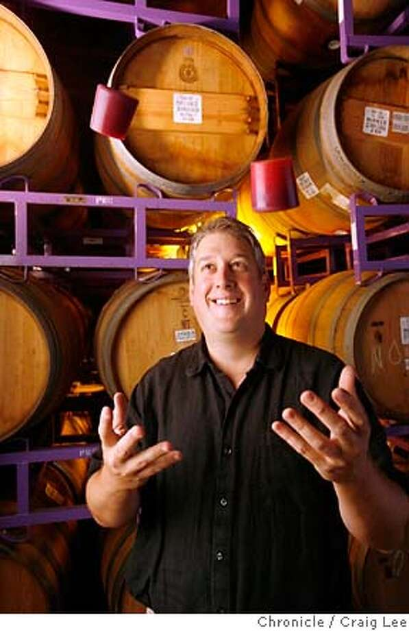 COSE31_117_cl.JPG  Alex Cose, winemaker for Purple Wine Company. Alex used to work for one of the most expensive wineries in California, Peter Michael winery, now he makes $10 Chardonnay. Photo of Alex Cose with his wine barrels on purple barrel racks behind him while he is tossing up in the air, purple bungs for his wine barrels.  Event on 8/9/07 in Graton. photo by Craig Lee / The Chronicle MANDATORY CREDIT FOR PHOTOG AND SF CHRONICLE/NO SALES-MAGS OUT Photo: Photo By Craig Lee