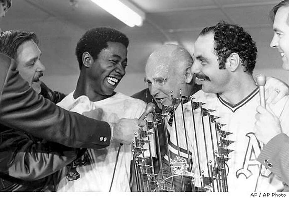 Champagne drips from the face of Oakland Athletics owner Charlie O. Finley, center, as he talks to reporters with players Allan Lewis and Sal Bando, right, in the dressing room in Cincinnati, Ohio, Oct. 22, 1972. Lewis scored the winning run in the sixth inning off a center field double by Bando to give the A's the World Series victory over the Cincinnati Reds in game seven. (AP Photo) Charles Finley celebrates 1972 World Series championship over the Cincinnati Reds with A's player Allan Lewis and Sal Bando (right).
