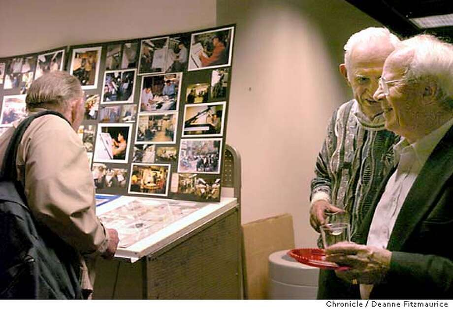 (l to r) Printers Mike Murphy looks at old pictures and Louis Van Velzen talks with Gus Woelfle (glasses). Party for retiring printers at the San Francisco Chronicle.  Event on 12/3/03 in . Deanne Fitzmaurice / The Chronicle Photo: Deanne Fitzmaurice