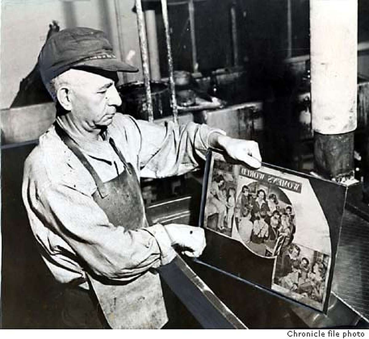 Etching zinc plate in nitric acid in The Chronicle engraving room, September 1946 Chronicle file photo