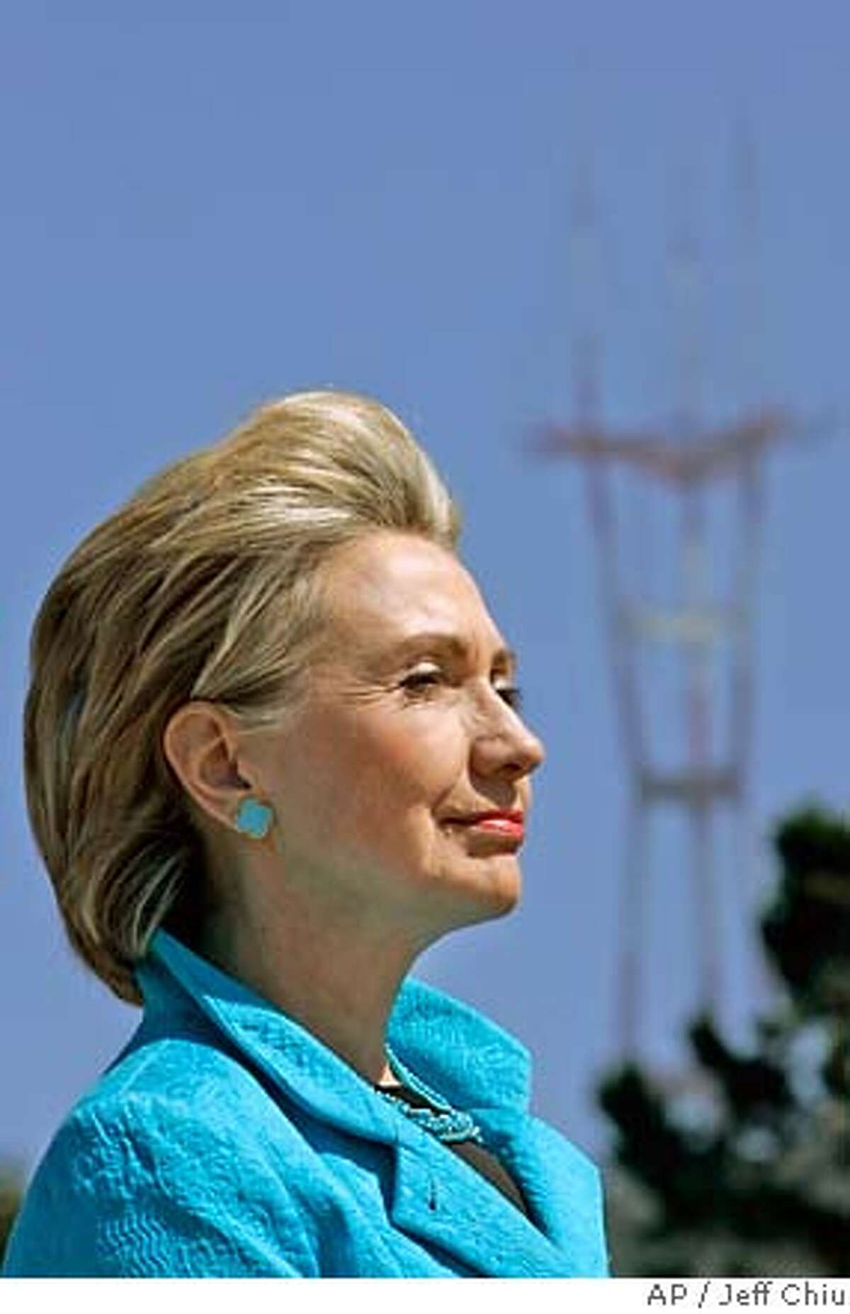 Presidential hopeful Sen. Hillary Rodham Clinton, D-N.Y., listens as San Francisco Mayor Gavin Newsom speaks at a news conference following a tour of the construction site of the California Academy of Sciences in San Francisco, Friday, Aug. 10, 2007. (AP Photo/Jeff Chiu)
