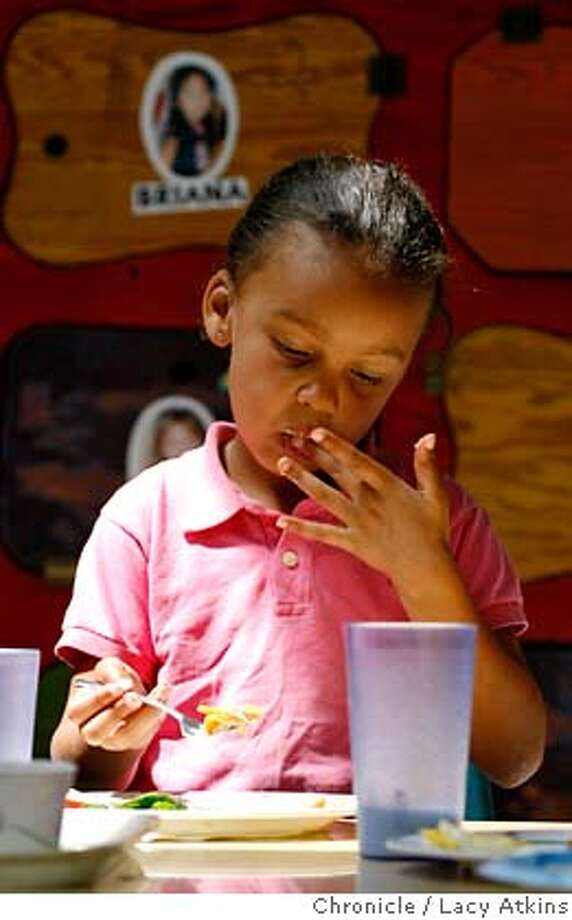 Mia Smith licks the Chilaquiles from her fingers during lunch at the Centro Vida Preschool, Tuesday Aug. 14, 2007, in Berkeley, CA, where they are starting to feel the crunch of the state's budget impasse which is six weeks overdue.(Lacy Atkins /San Francisco Chronicle)  *Mia Smith MANDATORY CREDITFOR PHOTGRAPHER AND SAN FRANCISCO CHRONICLE/NO SALES-MAGS OUT Photo: Lacy Atkins
