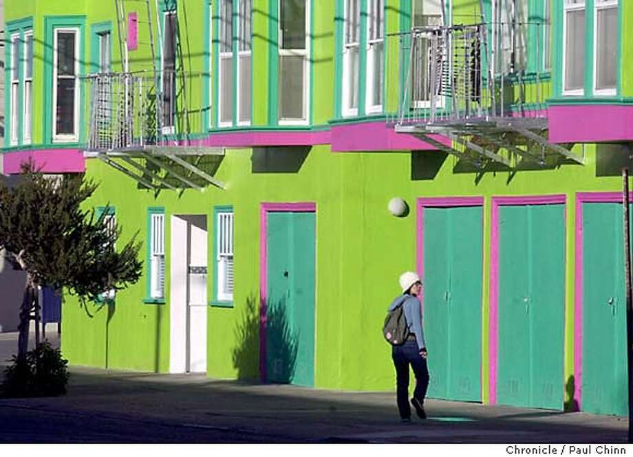 A passer-by checks out the lime green apartment building at Irving and LaPlaya. Voters in the Outer Sunset discuss the mayoral runoff election in San Francisco on 11/26/03. PAUL CHINN / The Chronicle Gary Goerss, who supports Gavin Newsom, has a view of Ocean Beach and the Marin Headlands from his front window. Photo: PAUL CHINN
