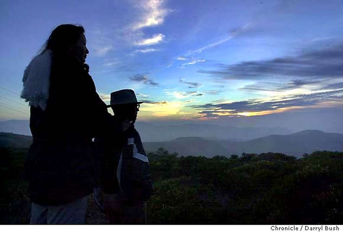 Sweeny Ridge fire trail. Steve Thornton and Casey daughter, 4, of Pacifica at beginning of trail. Eric Moberg of Mariposa and friend Charlotte Chan of South San Francisco at sunset. 11/19/03 in San Bruno. DARRYL BUSH / The Chronicle