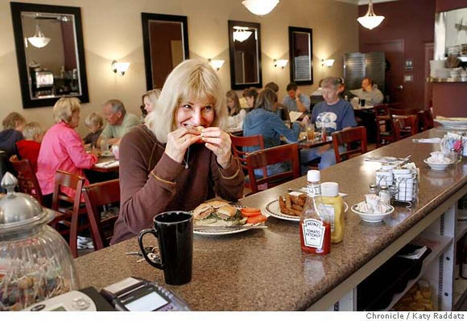 BARGAIN16_VALLY_020_RAD.jpg  SHOWN: Sue Weaver, a resident of Danville, takes a lunch break on her day off and bites into a cheesburger at New Vally Medlyn's, a restaurant in Danville, CA. (Vally IS the correct spelling). (Katy Raddatz/The Chronicle)  **Sue Weaver Mandatory credit for the photographer and the San Francisco Chronicle. No sales; mags out. Photo: Katy Raddatz