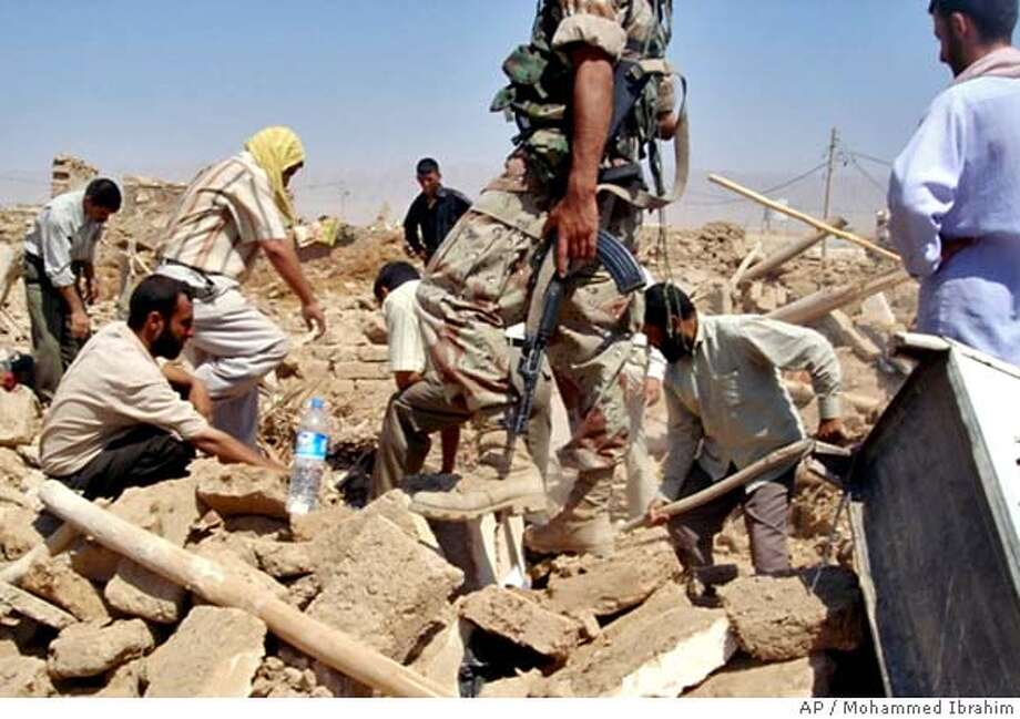 ** RETRANSMISSION FOR IMPROVED QUALITY **Men dig through rubble to search for survivors and dead on Wednesday, Aug. 15, 2007, after a coordinated suicide attack late Tuesday, in the town late of Qahataniya, 120 kilometers (75 miles) west of Mosul, Iraq. Rescuers dug through the muddy wreckage of collapsed clay houses in northwest Iraq on Wednesday, uncovering at least 250 bodies from suicide truck bombings the U.S. military blamed on al-Qaida, making it the deadliest attack since the war began. The victims of the attack, which the U.S. blamed on al-Qaida, were members of the Yazidis, a small Kurdish sect that has been the target of Muslim extremists who label it blasphemous. (AP Photo/Mohammed Ibrahim) RETRANSMISSION FOR IMPROVED QUALITY Photo: MOHAMMED IBRAHIM