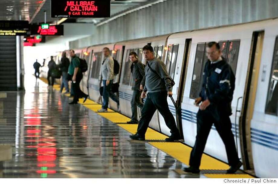 Air travelers exit a train at the SFO BART station in San Francisco, Calif. on Friday, July 7, 2006. Fewer riders are taking advantage of the service than BART officials had hoped for when the service began three years ago despite the convenience of BART's station directly inside the international terminal. PAUL CHINN/The Chronicle MANDATORY CREDIT FOR PHOTOGRAPHER AND S.F. CHRONICLE/NO SALES - MAGS OUT Photo: PAUL CHINN