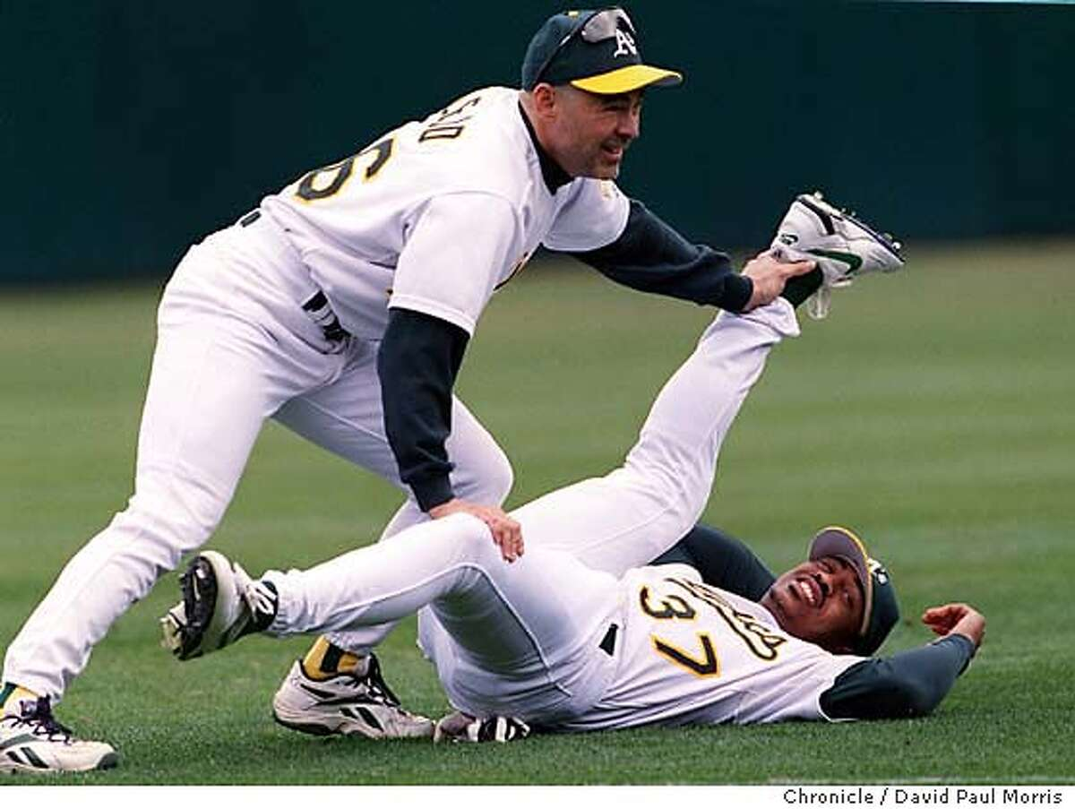 PLAYOFFa-C-28SEPT00-SP-DPM-Oakland A's Center fielder Terrence Long stretches out with Bob Alejo the A's strength and Conditioning Coach. Chronicle photo by David Paul Morris CAT
