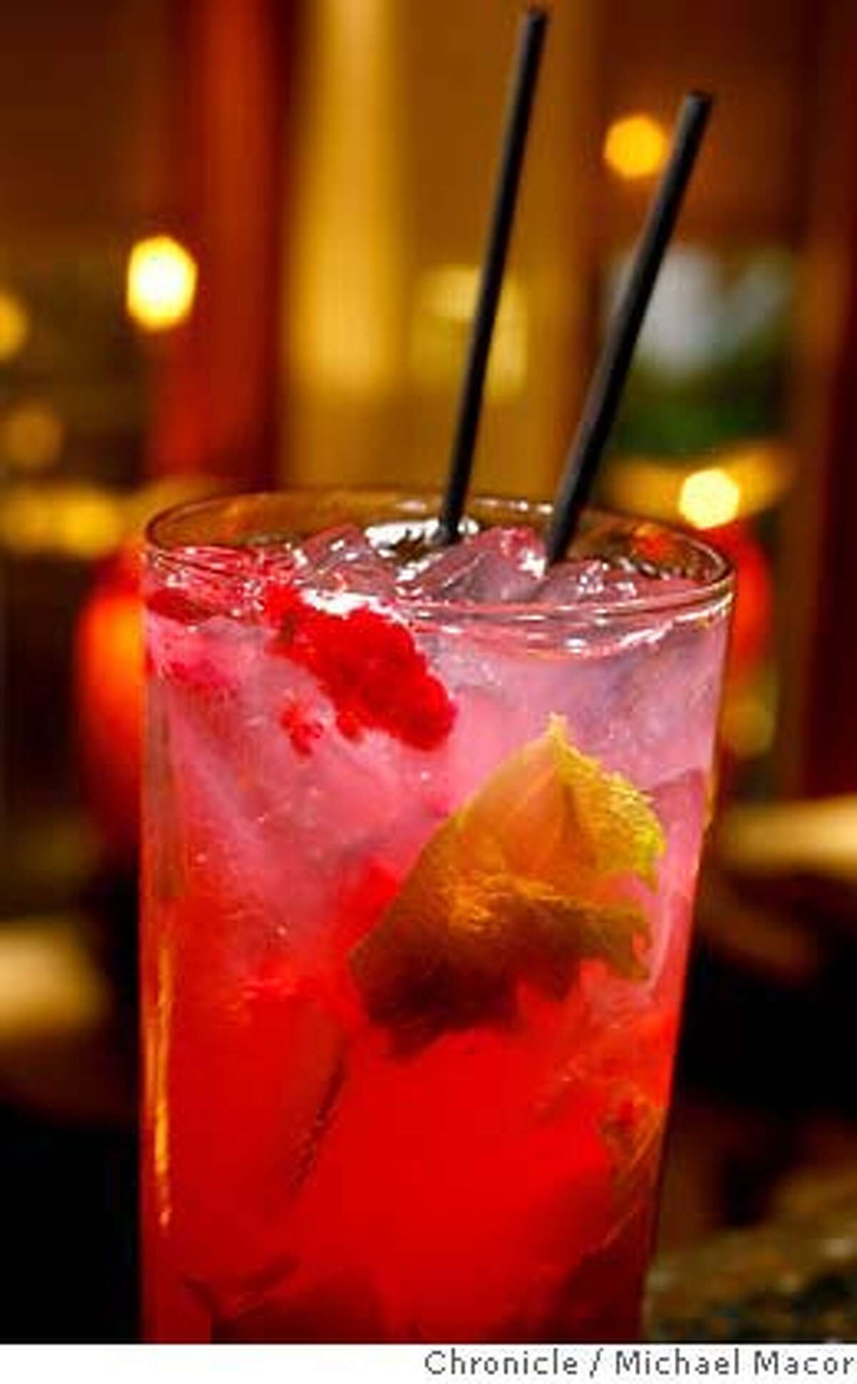 """barbites16_013_mac.jpg """"Raspberry-Shiso Ginger Ale - Raspberries and Shiso leaves muddled with simple syrup and sweet and sour, mixed with house infused Ginger Vodka with a slash of soda. 96 Hours Bar Bites feature the scene, people, food and drink at Anzu restaurant's lounge. This is a comfortable living-room style lounge and bar area before you enter the restaurant. Photographed in, San Francisco, Ca, on 7/31/07. Photo by: Michael Macor/ The Chronicle Mandatory credit for Photographer and San Francisco Chronicle No sales/ Magazines Out"""