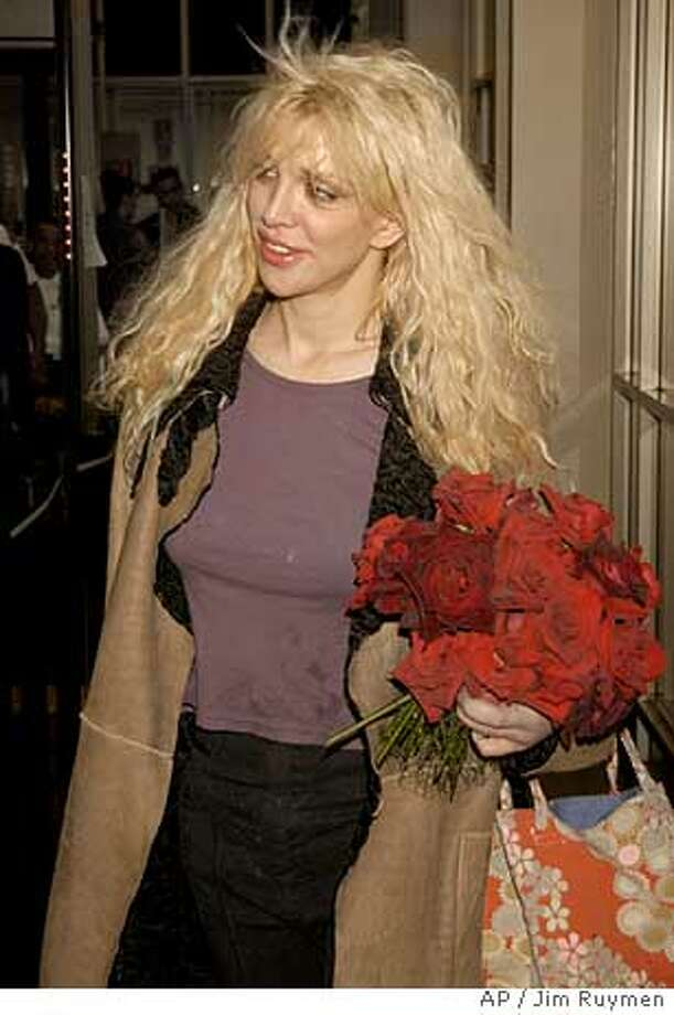 Actress-singer enters Los Angeles County Superior Court Wednesday, Nov. 12, 2003, in Beverly HIlls, Calif. Love was arraigned Wednesday on two felony counts of drug possession. (AP Photo/Jim Ruymen, Pool) Photo: JIM RUYMEN