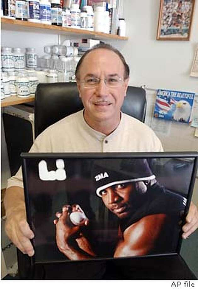 BALCO founder Victor Conte holds a photo of San Francisco Giants' Barry Bonds with the drug ZMA that Conte makes on Bond's hat, at his office in Burlingame, Calif., Tuesday, Oct. 21, 2003. Conte has been accused by the U.S. Anti-Doping Agency of supplying athletes with a new designer steroid that is rocking the world of track and field. Bonds will testify in December before a federal grand jury that has subpoenaed several dozen athletes as part of its probe into a laboratory that supplies some of the nation's top sports stars with nutritional supplements. In background is other drugs BALCO produces. (AP Photo/Paul Sakuma) Victor Conte is a former bassist for Tower of Power who turned into a nutritional guru. Victor Conte is a former bassist for Tower of Power who turned into a nutritional guru. Victor Conte is a former bassist for Tower of Power who turned into a nutritional guru. Photo: PAUL SAKUMA