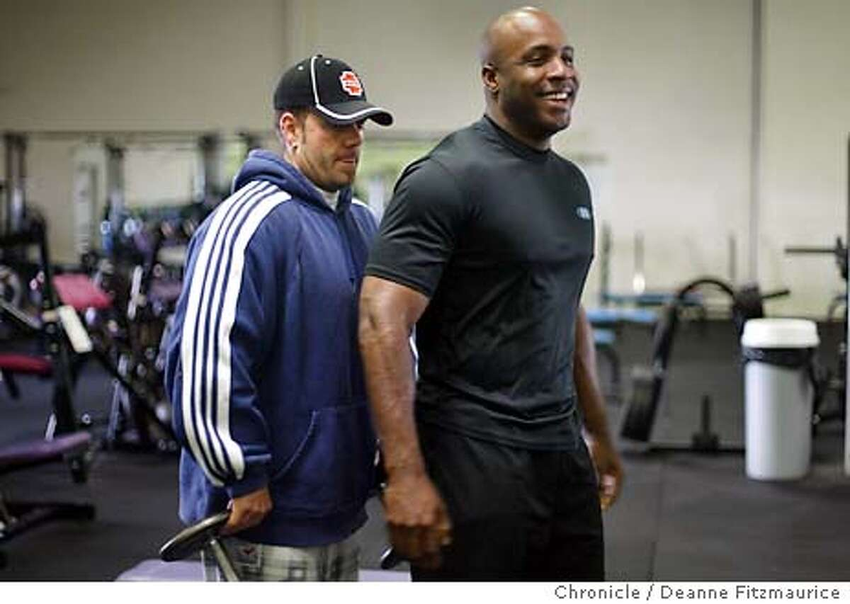 bonds_001_df Barry Bonds works out with personal trainer, Greg Anderson. Shot on August 5, 2002.