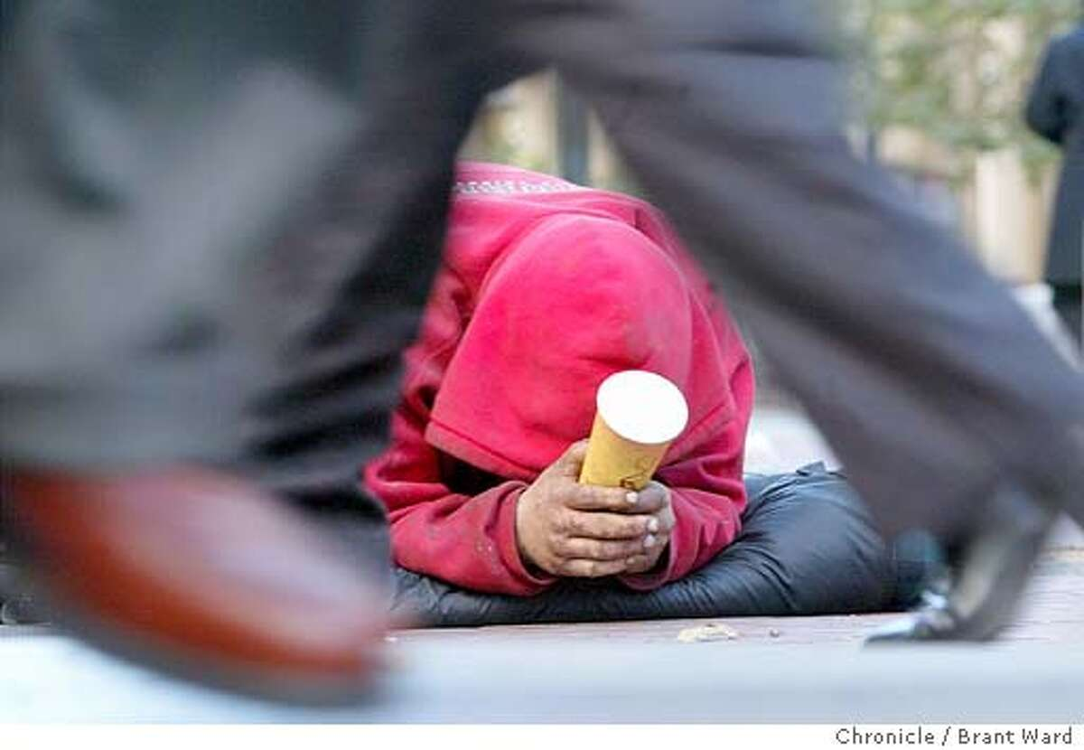Outside the Montgomery BART station on Market Street, a homeless man begged for money as people left the station. BRANT WARD / The Chronicle