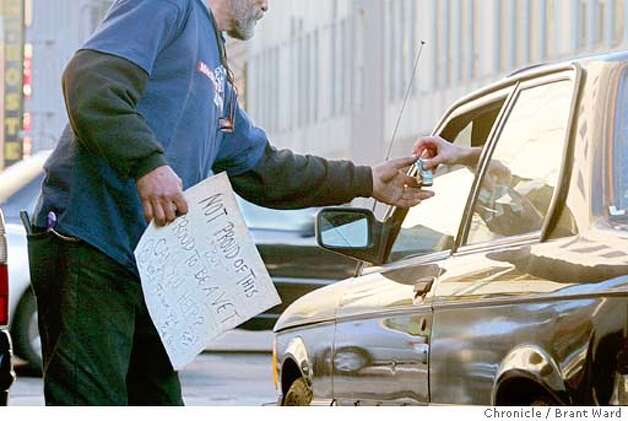 On Fell Street in San Francisco, a homeless man accepted a dollar from a motorist. BRANT WARD / The Chronicle Photo: BRANT WARD