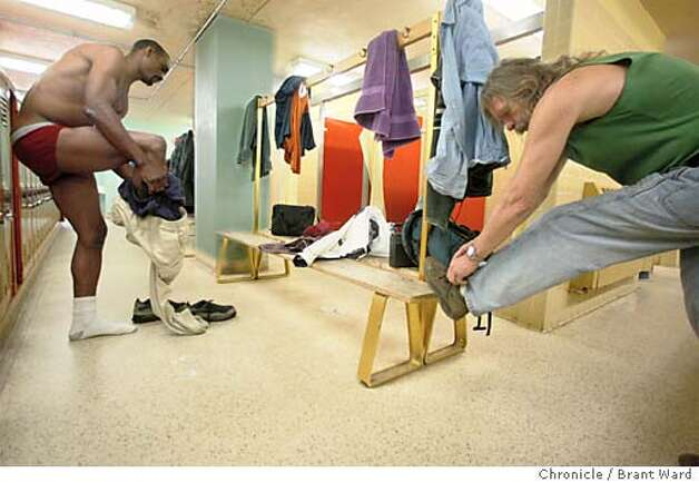 Alvin, left, and Stephen, two homeless men undressed in the girl's locker room at Mission High School for a shower. The program, sponsored by the Metropolitan Community Church allows homeless men and women to shower on Saturdays at the empty gym. BRANT WARD / The Chronicle Photo: BRANT WARD