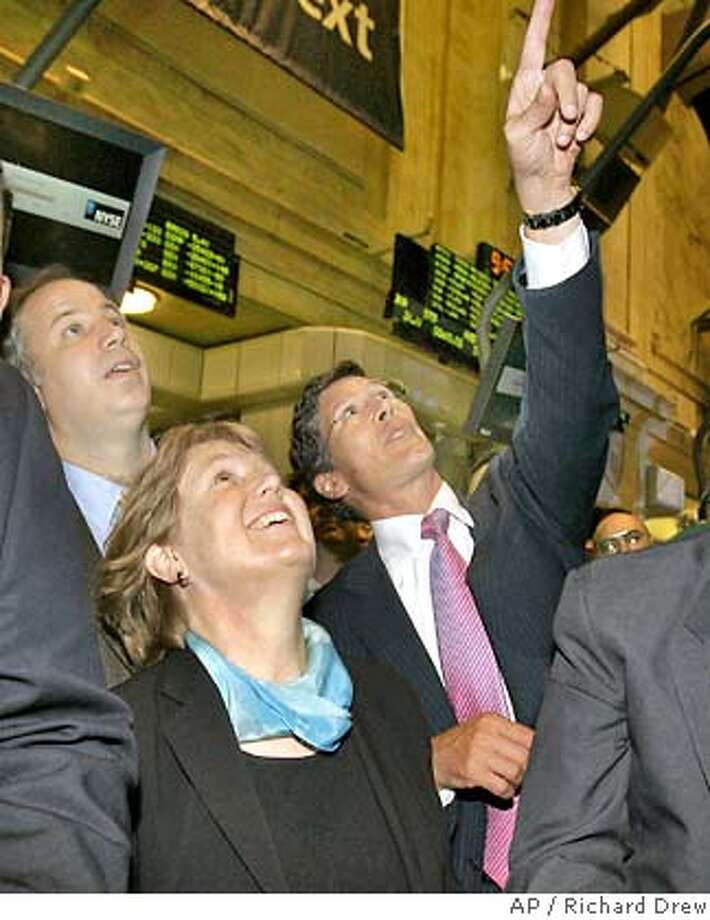 Diane Green, president and CEO of VMware Inc., Mendl Rosenblum, left, Greene's husband and VMware's chief scientist, and NYSE CEO John Thain watch as the first trade crosses the ticker on the floor of the New York Stock Exchange during the company's initial public offering, Tuesday, Aug. 14, 2007. (AP Photo/Richard Drew) Photo: RICHARD DREW