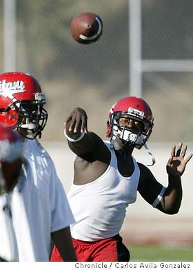 """Charles """"Junior"""" Roberson, throws the ball during a play drill during practice at Skyline High School in Oakland, Ca., on Thursday, October 16, 2003. Profile of Skyline High School quarterback, Charles Roberson, who is called """"Junior"""" by everyone at school. He has taken over the quarterback role after years of playing running back. Carlos Avila Gonzalez / The San Francisco Chronicle Photo: Carlos Avila Gonzalez"""