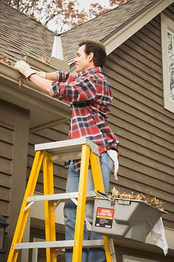 Handy LadderPail in use on a ladder Photo: Handout