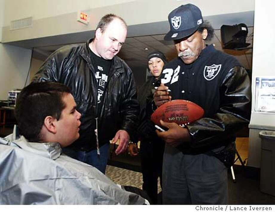 tatum02_li.jpg Former Raiders safety Jack Tatum signs a ball for 16 year-old Carl Bernard (from Waterford, Ontario, Canada) his father Kevin Bergie is in the background. This is before the Raiders played the Denver Broncos, Sunday November 30th, 2003. It was Tatum's first public appearance in years.  Lance Iversen / The San Francisco Chronicle Photo: LANCE IVERSEN