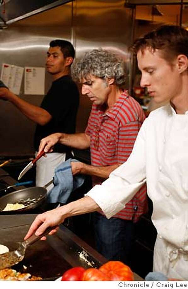 CHEFSNIGHTIN_006_cl.JPG  Tony Gulisano, chef/owner of Chow restaurant in San Francisco and Layfayette, shows the proper way to cook eggs. This was at Layfayette restaurant. Tony Gulisano (middle), Adam Marchetti (right), the Executive Chef, and, Juan Jacobo (left), line cook.  Event on 8/7/07 in Layfayette. photo by Craig Lee / The Chronicle MANDATORY CREDIT FOR PHOTOG AND SF CHRONICLE/NO SALES-MAGS OUT Photo: Photo By Craig Lee