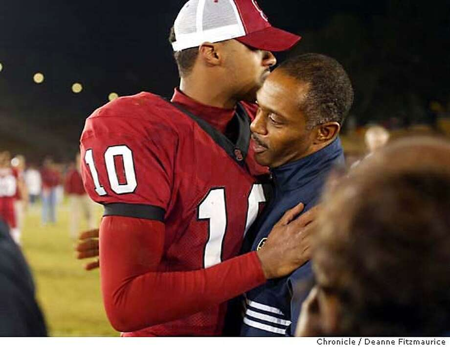 Tyrone Willingham hugs quarterback, Chris Lewis. Stanford Cardinal lose to Notre Dame Fighting Irish at Stanford Stadium. Shot on November 29, 2003. Photo by Deanne Fitzmaurice Photo: Deanne Fitzmaurice