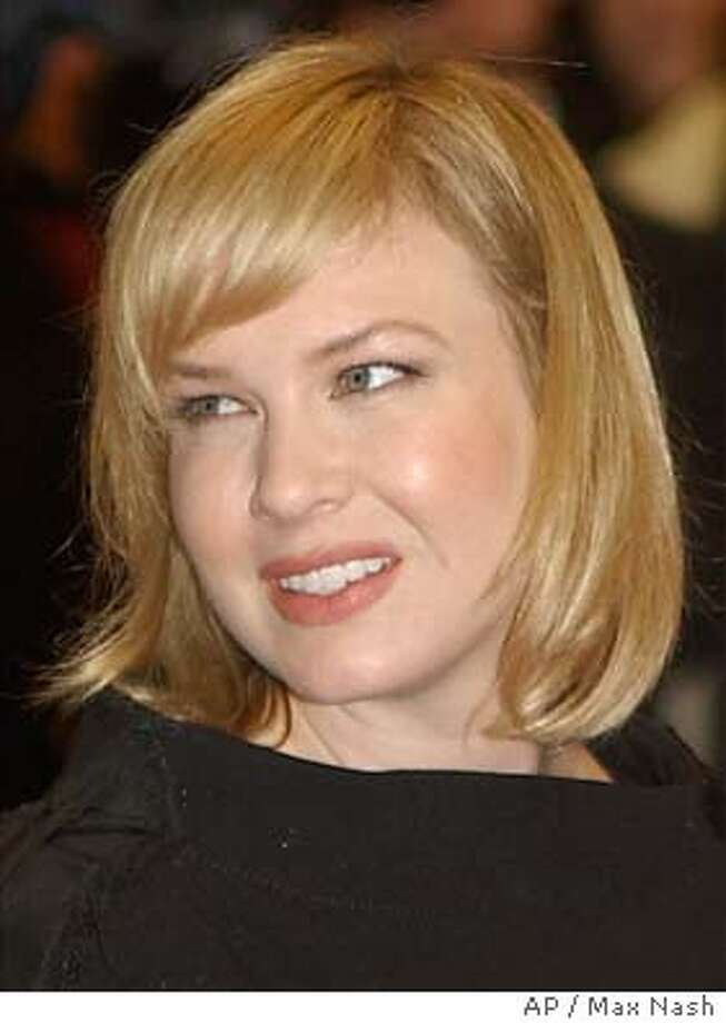 **FILE** Renee Zellweger, shown in London in this Oct. 1, 2003, file photo, doesn't see what the big deal is about the fact that she put on weight to play Bridget Jones. The petite actress packed on the pounds for ``Bridget Jones's Diary'' in 2001, then slimmed back down for last year's ``Chicago,'' and now she's plumped up again for the sequel ``Bridget Jones: The Edge of Reason,'' due out next year. Associated Press photo by Max Nash Photo: MAX NASH