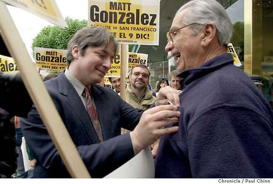 sfmayor30068_pc.jpg Matt Gonzalez pins a campaign button on supporter Ricardo Callejo on West Portal Ave. Mayoral candidate Matt Gonzalez campaigns in the West Portal neighborhood in San Francisco on 11/29/03. PAUL CHINN / The Chronicle MANDATORY CREDIT FOR PHOTOG AND SF CHRONICLE/ -MAGS OUT Photo: PAUL CHINN